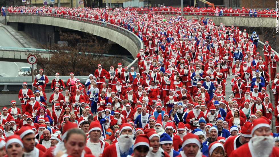 Runners dressed in Father Christmas costumes take part in the annual 5-kilometer Santa Dash in Liverpool, England, on Sunday, December 2. Many runners who refuse to run in red, the color of their football rivals Liverpool FC, wear blue to support the football team Everton FC.<br /><br />
