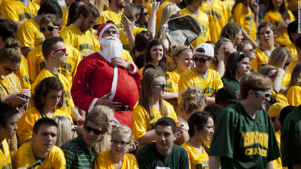 A fan of the Baylor University Bears dresses up as Santa Claus while the Bears face the Oklahoma State University Cowboys on Saturday, December 1, in Waco, Texas.