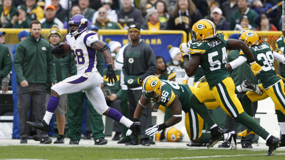 Adrian Peterson of the Minnesota Vikings breaks free for an 82-yard touchdown run against the Green Bay Packers at Lambeau Field on Sunday in Green Bay, Wisconsin.