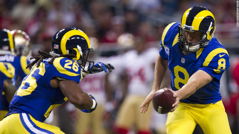 Quarterback Sam Bradford of the St. Louis Rams hands off the ball on Sunday.