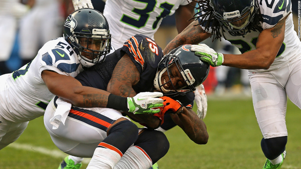 Brandon Marshall of the Chicago Bears is tackled after a catch by Bobby Wagner, left, and Earl Thomas of the Seattle Seahawks on Sunday.