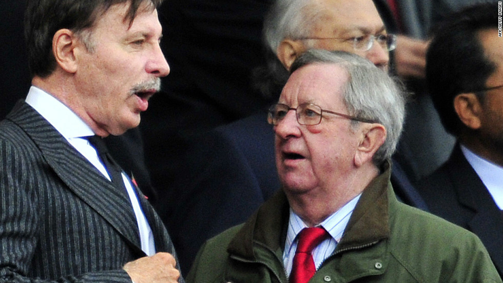 Arsenal long-serving chairman Peter Hill-Wood, seen here to the right of the club's  majority shareholder Stan Kroenke, suffered a heart attack the day before the Swansea game.