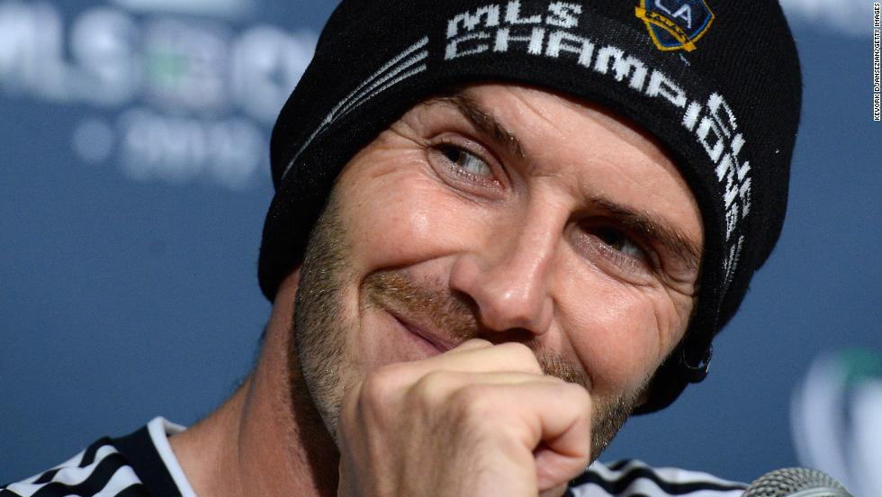 David Beckham ended his five-year stint in America's pro soccer league in style Saturday as his team, the Los Angeles Galaxy, won the MLS Cup. The Galaxy defeated the Houston Dynamo 3-1 to win the cup for the second year in a row. Nearly two weeks ago, the team announced that Saturday's game would be Beckham's last with the team. Pictured, Beckham addresses the media after the game on Saturday, December 1, in Carson, California.