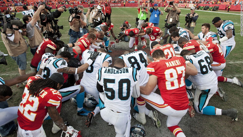 Players from the Kansas City Chiefs and Carolina Panthers gather at midfield for a prayer after the Chiefs' 27-21 win.