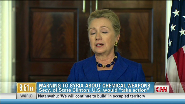 Clinton issues stern warning to Syria