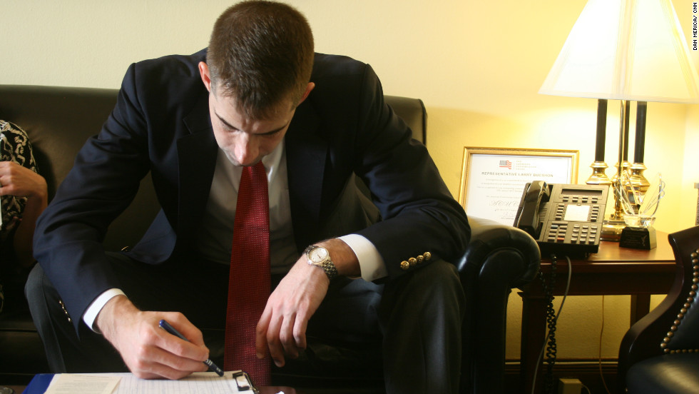 U.S. Rep.-elect Tom Cotton of Arkansas studies a spreadsheet in a down moment during the office selection process.