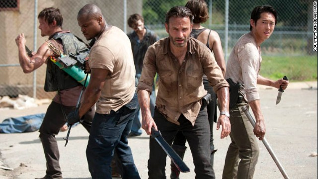 "Norman Reedus, from left, IronE Singleton, Andrew Lincoln and Steven Yeun star in AMC's ""The Walking Dead."""