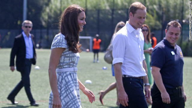 Catherine (L), The Duchess of Cambridge kicks a ball as she walks with her husband Prince William during a visit to Bacon's College in London to launch the 'Coach Core' programme, a partnership between their foundation and the sports charity Greenhouse. They saw different sports being coached to local children and took part in some of the training. AFP PHOTO/POOL / Richard Pohle (Photo credit should read RICHARD POHLE/AFP/GettyImages)