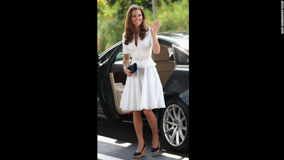 Wearing a white suit by Alexander McQueen, the Duchess of Cambridge arrived at Singapore's Gardens by the Bay on September 12.