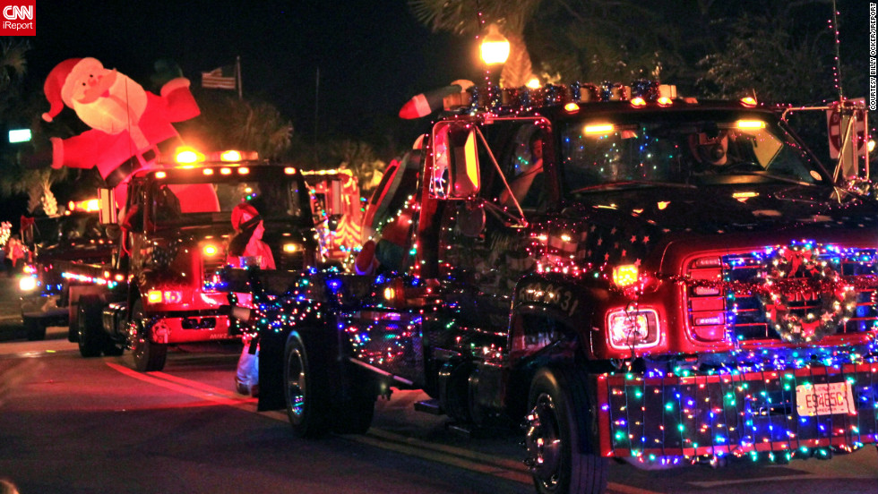 "In the Floridian coastal town of Sebastian, ""people decorate cars and boats to show their spirit of Christmas"" before parading them through town, said <a href="" http://ireport.cnn.com/people/postman555"">Billy Ocker</a>. ""Old cars, boats, bikes, tow-trucks, fire trucks and floats,"" are a common sight. ""Anything that has wheels would be allowed,"" he added."