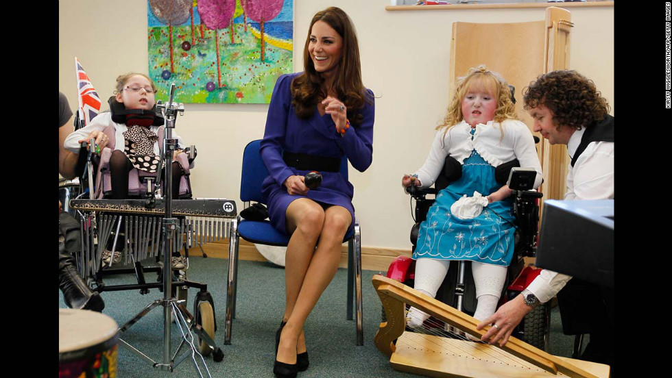 Catherine joins in a music class during a visit to The Treehouse in Ipswich, eastern England, on March 19, 2012. Her visited marked the formal opening of The Treehouse, a children's hospice service for the counties of Suffolk and Essex.