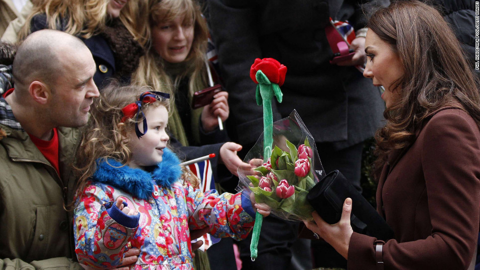 A young girl offers Catherine a toy rose as the Duchess visits Alder Hey Children's Hospital on February 14, 2012, in Liverpool, England. Interacting with children during visits to hospital or charities is a part of official duties that Catherine seems to enjoy.