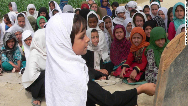 Afghan schoolgirls study in an open air school in Jalalabad. Violence against women is a major problem in Afghanistan.
