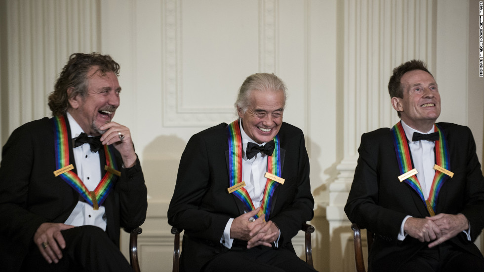 Led Zeppelin's Robert Plant, Jimmy Page and John Paul Jones share a laugh at the White House reception Sunday before the awards ceremony.