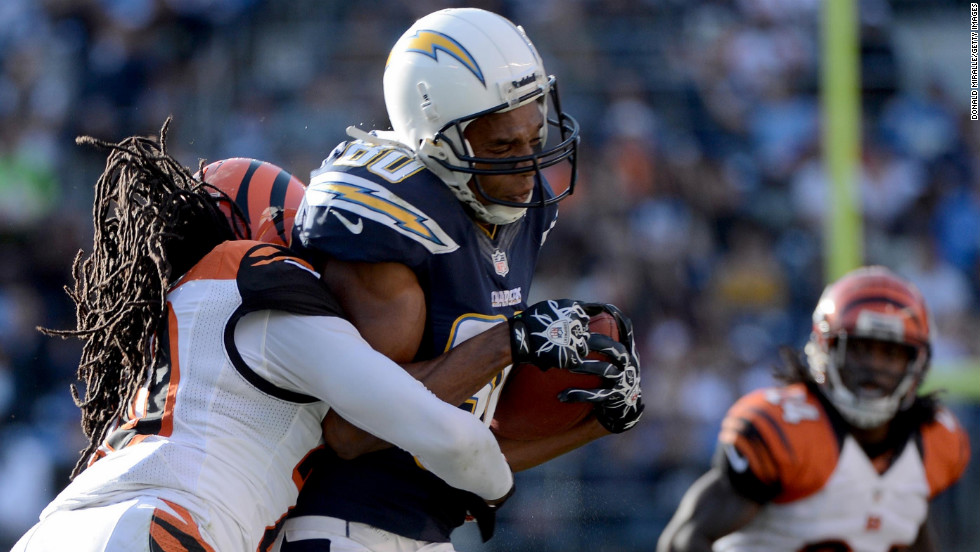Malcom Floyd of the San Diego Chargers gets tackled by Reggie Nelson of the Cincinnati Bengals on Sunday.