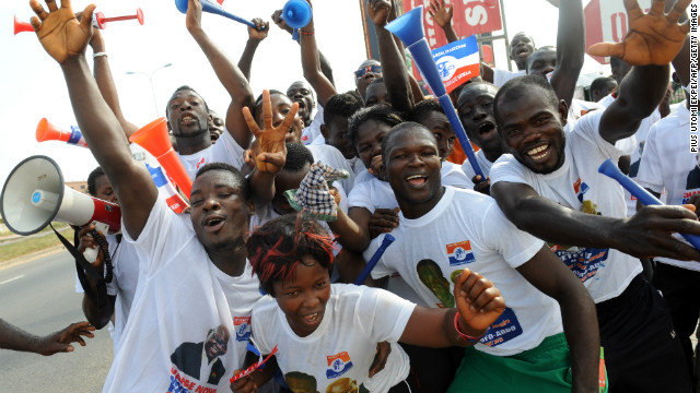 Supporters of Ghana's New Patriotic Party, hold vuvuzelas as they dance in the streets of Kasoa, Ghana, on December 1, 2012.