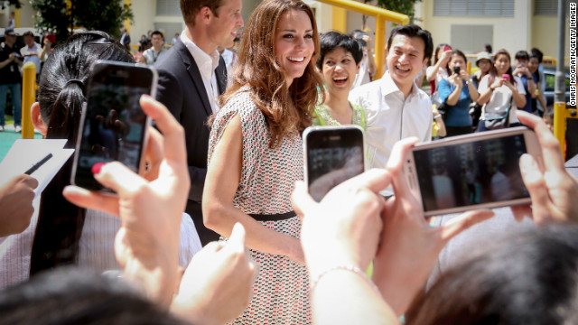 Catherine, Duchess of Cambridge is photographed by members of public on September 12, 2012 in Singapore.