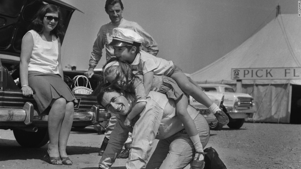 "Former world champion Jackie Stewart, seen here playing with the children of F1 rival Graham Hill, was remarkably friendly with his peers, Tu says. ""He was incredibly fond of a number of people who drove with him. That partly is because there was a clearer distinction of him being a number one and them being number two drivers."""