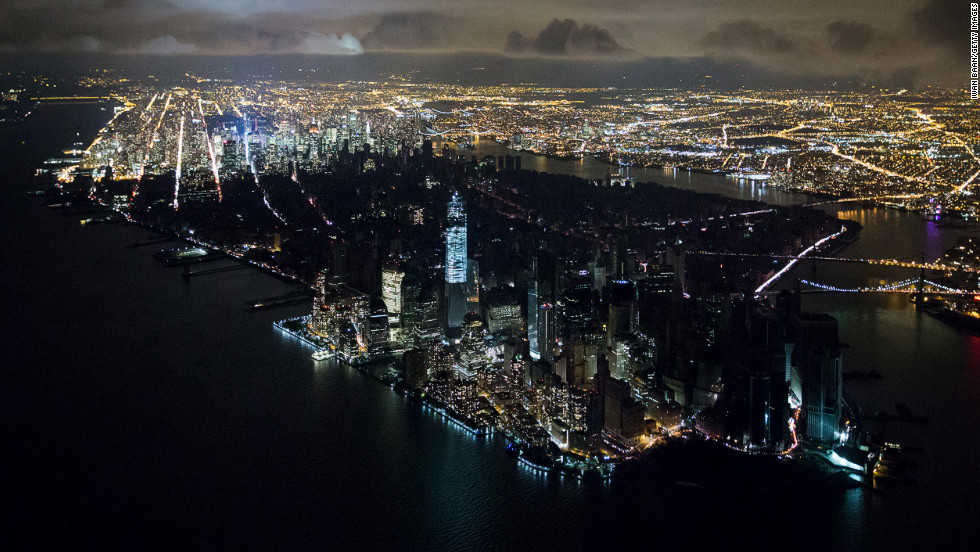 <strong>November 1:</strong> An aerial view of New York reveals a widespread power outage after Superstorm Sandy. Photographer Iwan Baan credits his camera for allowing him to capture the memorable image from a helicopter at night. He told the Poynter Insitute that with older equipment, the shot would have been impossible.