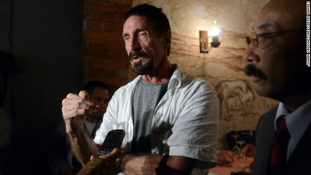 US anti-virus software pioneer John McAfee (L) answers questions to a journalist next to his Guatemalan lawyer Telesforo Guerra (R), in a restaurant in Guatemala City on December 04, 2012. McAfee, wanted for questioning over the murder of his neighbor last month in Belize, is seeking political asylum in Guatemala.