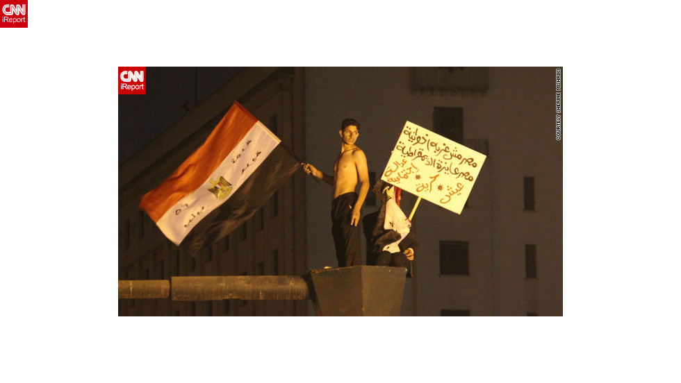 "At earlier protests, those gathered were ""hopeful and very determined,"" said iReporter Sherine Mishriki, who sent in this image of youths <a href=""http://ireport.cnn.com/docs/DOC-887373"">waving flags and placards</a> in Cairo's iconic Tahrir Square on November 27."