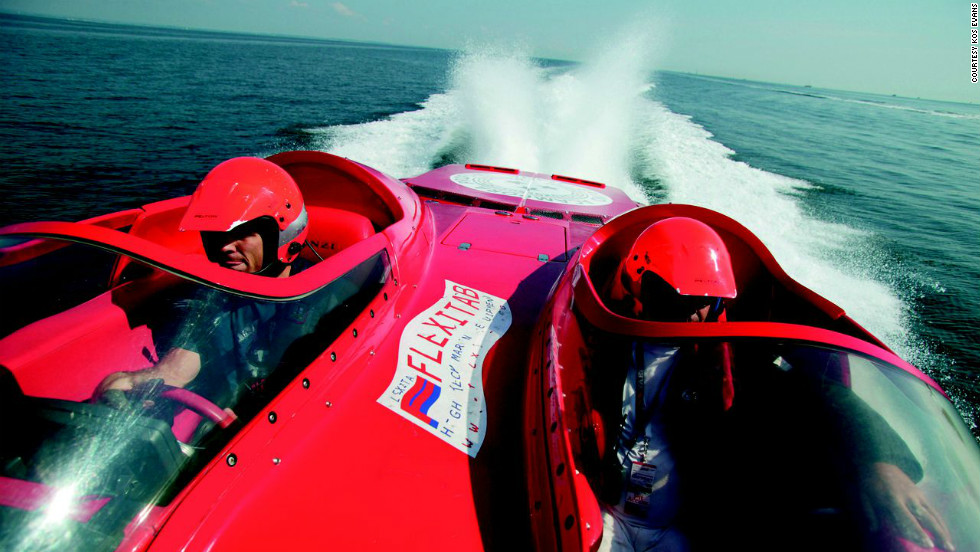 "Kos is also known for her spectacular images of the World Champion Powerboat competition. ""There was no room for me in the cockpit, so the only solution was for me to hang onto the foredeck as we sped along at 150kmph,"" she said of this image."