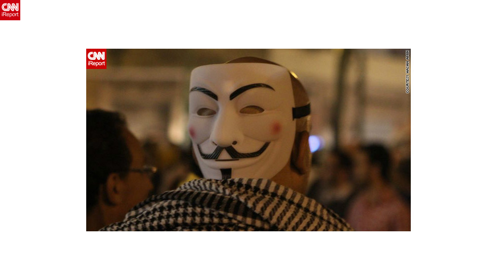 "Anti-Morsy protesters said they feared a return to the days of ousted President Hosni Mubarak. Some appropriated iconic images from other global protests, such as <a href=""http://ireport.cnn.com/docs/DOC-886658"">this man </a>in iReporter Hasan Amin's image from November 24, who wore a mask borrowed from Alan Moore's comic ""V for Vendetta"" and frequently seen on global ""Occupy"" demonstrators."