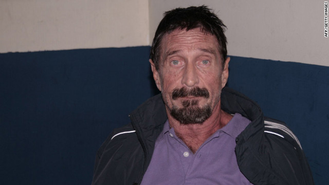 Handout picture released by the office of the Human Rights Ombudsman of Guatemala of US internet security pioneer John McAfee being interrogated by Interpol at police headquarters December 5, 2012 after he was arrested in the Guatemalan capital for illegal entry, according to police. McAfee requested political asylum in Guatemala, his lawyer said December 5, 2012, after fleeing Belize where he is wanted for questioning over his neighbor's murder.