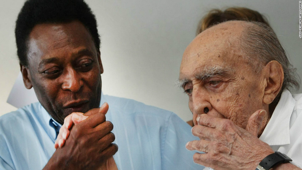 Brazilian football legend Edson Arntes do Nascimento, known as Pele, kisses Niemeyer's hand on November 4, 2010, in Rio de Janeiro during a press conference. Niemeyer was in charge of the design for a Football Museum in Santos.
