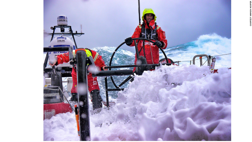 """It's an investment to have the right camera equipment that can withstand the salt water,"" award organizer Bernard Schopfer said. Photographer Hamish Hooper was well prepared when he took this image of sailors battling waves in the Southern Ocean."