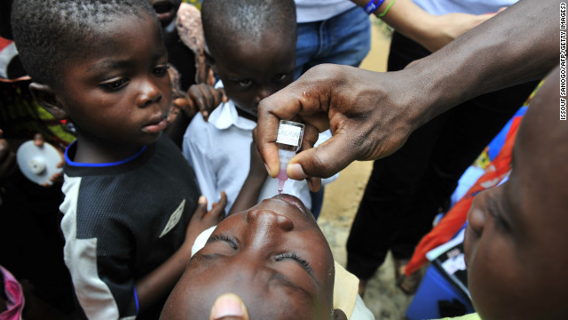 A child receives an oral polio vaccine in June 2011, in Abidjan, Ivory Coast.
