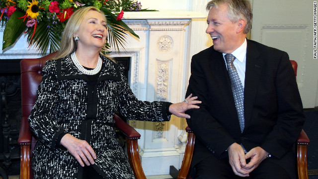 U.S. Secretary of State Hillary Clinton talks with Northern Ireland First Minister Peter Robinson in Belfast on Friday.