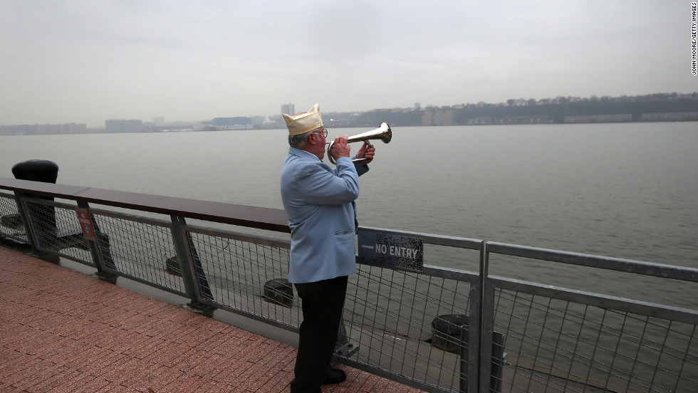 "Catholic War Veterans New York State Commander James Mullarkey plays ""Taps"" during a ceremony in New York."