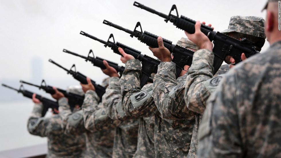 An honor guard fires a seven-gun salute in New York.