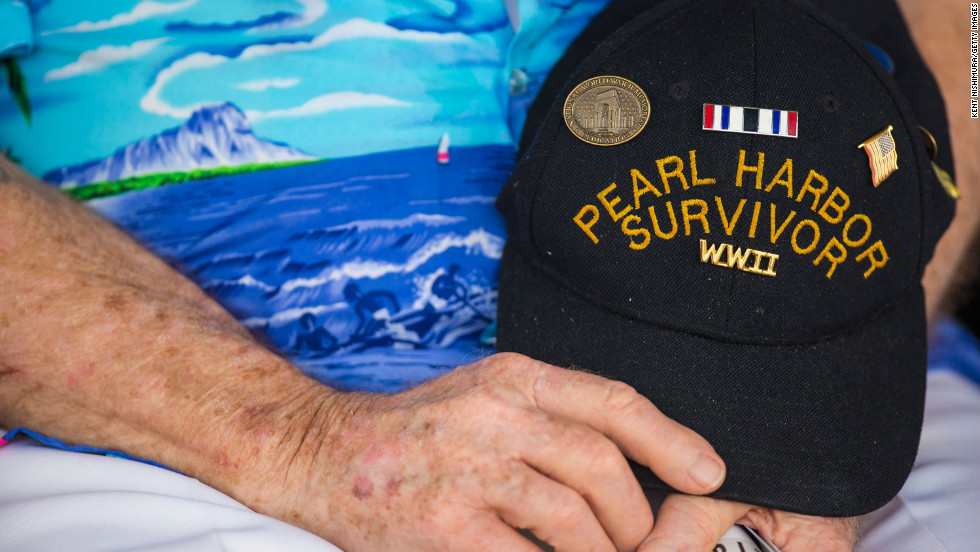Pearl Harbor survivor Paul Kennedy of Indiana holds his hat during the singing of the National Anthem in Pearl Harbor, Hawaii.