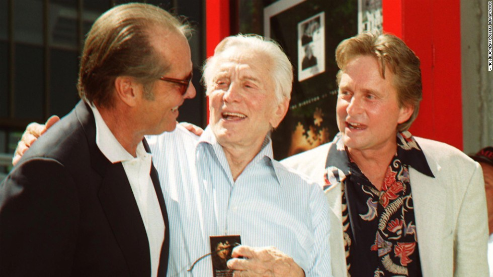 "Actor Jack Nicholson greets Kirk Douglas and his son, Michael, after a ceremony honoring Michael, who placed his hands and footprints in cement at Grauman's Chinese Theatre in 1997. Michael Douglas is the first ""second generation"" movie star to be honored. Kirk Douglas' handprints were imprinted there in 1962."