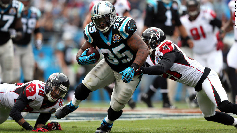 Falcons teammates Chris Owens and Thomas DeCoud tackle Mike Tolbert of the Panthers on Sunday.