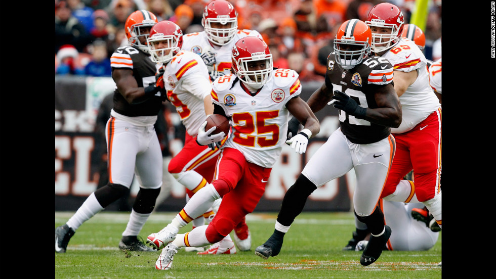 Running back Jamaal Charles of the Kansas City Chiefs scores a touchdown as he runs by linebacker D'Qwell Jackson of the Browns on Sunday.