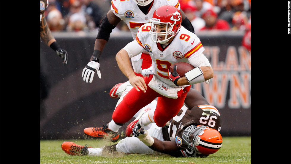 Quarterback Brady Quinn of the Chiefs is sacked by defensive lineman Frostee Rucker of the Browns on Sunday.
