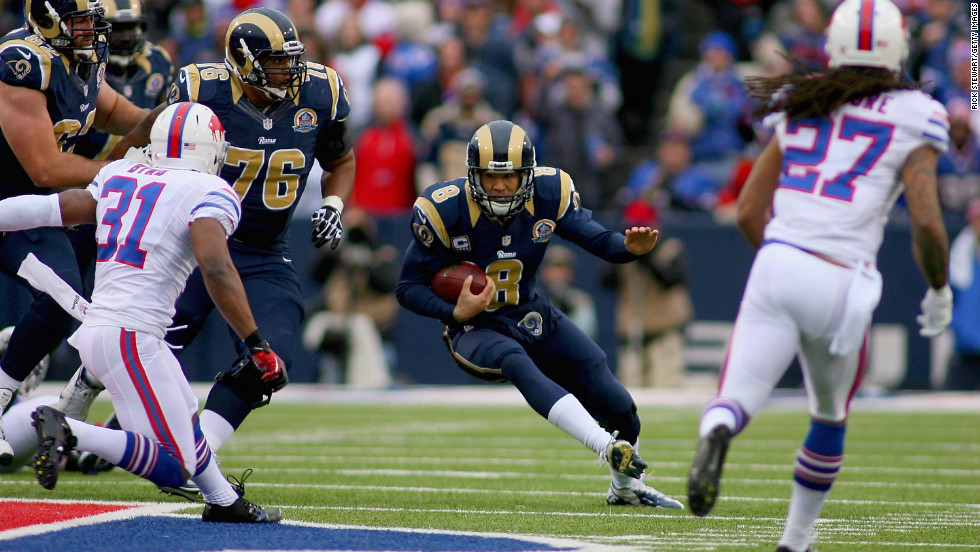 Rams quarterback Sam Bradford scrambles against the Bills on Sunday.