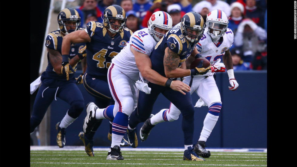 Rams linebacker James Laurinaitis picks up a fumble as he is tackled by David Snow of the Bills after the Bills turned the ball over on Sunday.