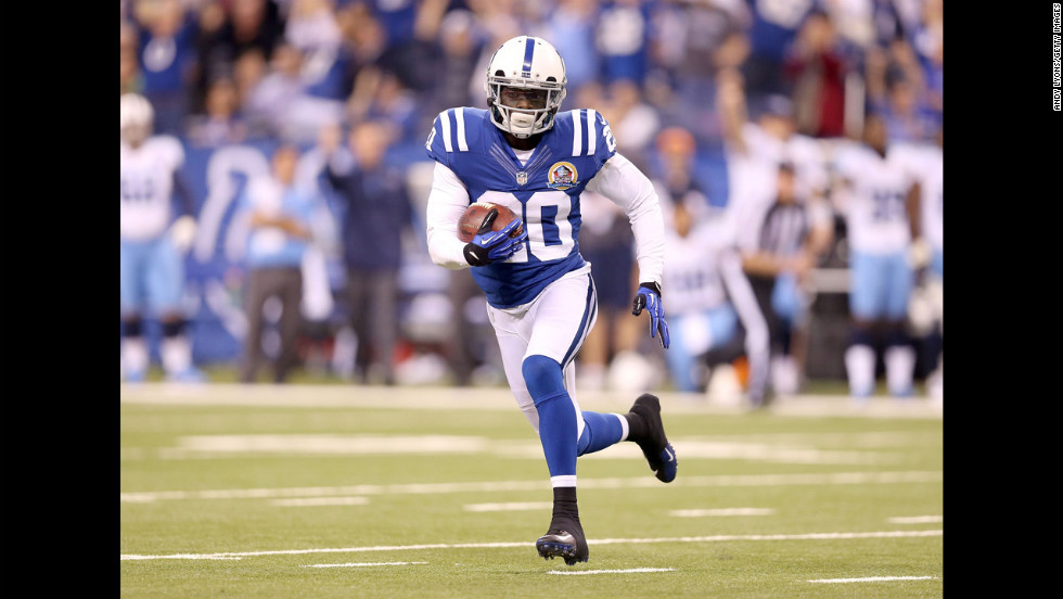 Colts cornerback Darius Butler runs with the ball after intercepting a pass on Sunday.