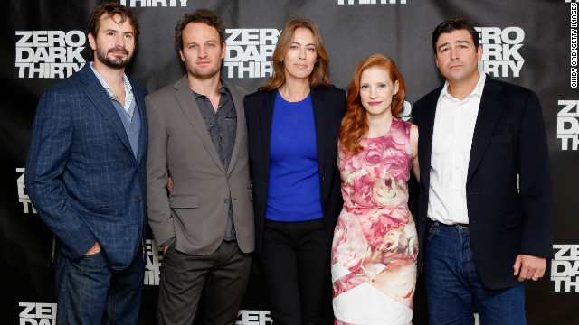 "Screenwriter Mark Boal, left, and director Kathryn Bigelow, center, pose with cast members of ""Zero Dark Thirty."""