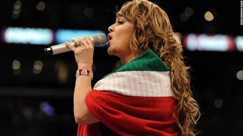 Rivera takes on the Mexican national anthem before the junior middleweight boxing bout between Shane Mosley and Sergio Mora in September 2010 at the Staples Center in Los Angeles.