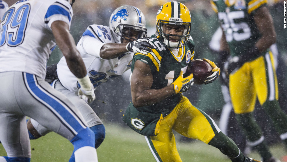 Packers wide receiver Randall Cobb breaks through a tackle on Sunday.