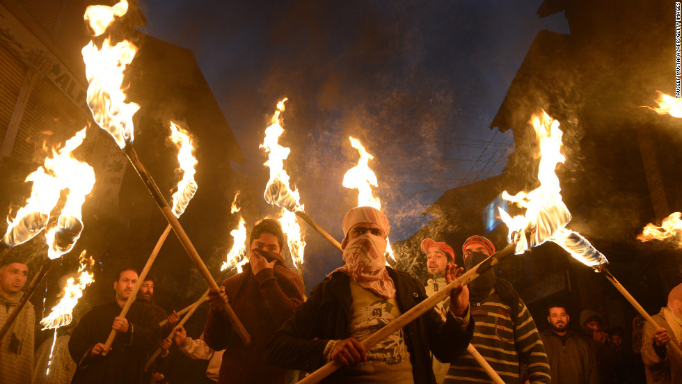 Activists and supporters of Jammu Kashmir Liberation Front shout anti-India slogans as they carry torches during a protest march to mark Human Rights Day in Srinagar, India, on December 10. A demonstration was held in Srinagar to protest against alleged human rights violations and a court verdict sentencing two Kashmiris to life imprisonment.