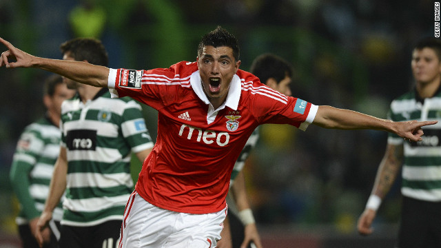 Paraguayan striker Oscar Cardozo celebrates as he aids Benfica's comprehensive defeat of struggling city rivals Sporting.