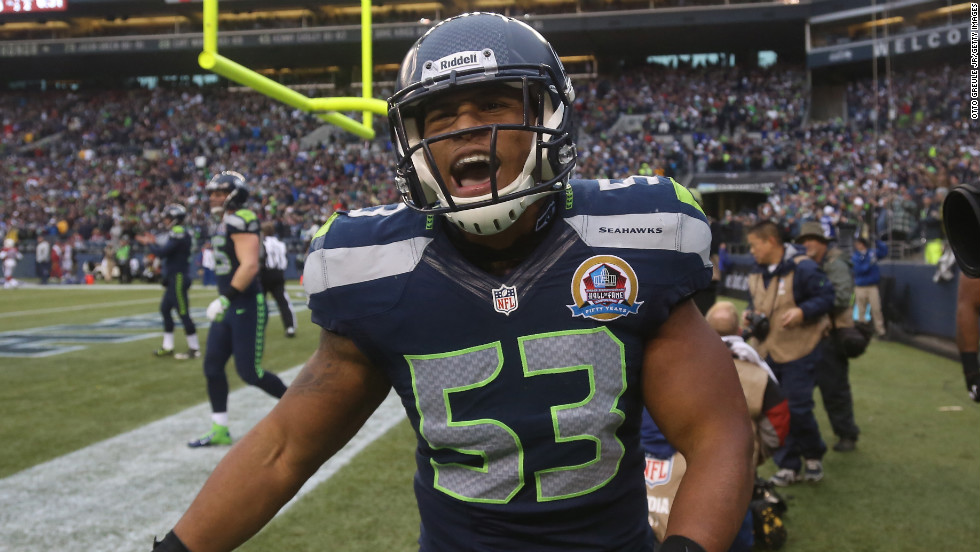 Seattle Seahawks linebacker Malcolm Smith celebrates after scoring a touchdown on a fumbled punt against the Arizona Cardinals at CenturyLink Field on Sunday, December 9, in Seattle, Washington.