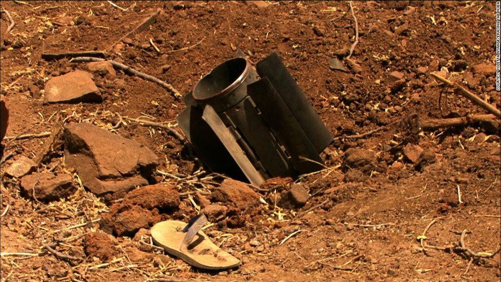 Nyange says this scene from the documentary shows a rocket fired by the Sudanese military, which fell inside a compound that housed a Nuba family.