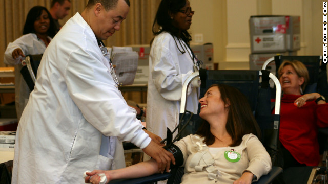 Meredith Forrester donates blood for the first time since undergoing two life-saving emergency surgeries after the shooting.